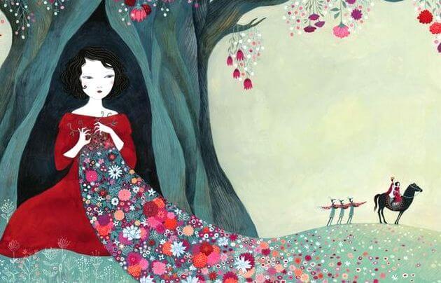 Kvinde sidder i træ med blomstertæppe