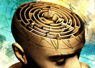 Mand med labyrint i hjernen, hvor små mænd udøver manipulation