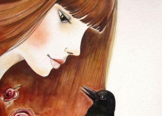 En rødhåret pige taler med en krage