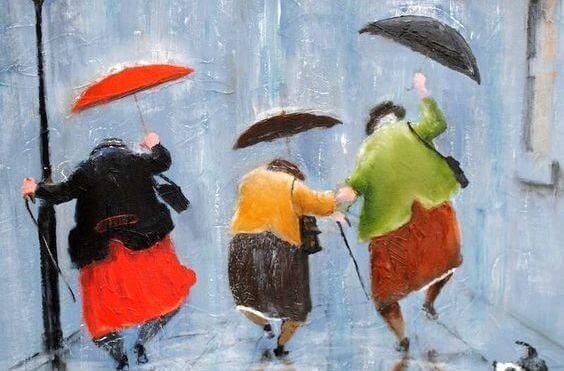 Ældre damer danser i regnen og lader sige ikke begrænse af deres alder