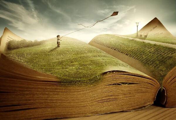 Et barn flyver med drage i en bog