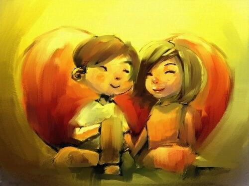 Smilende par der holder hinanden i haanden