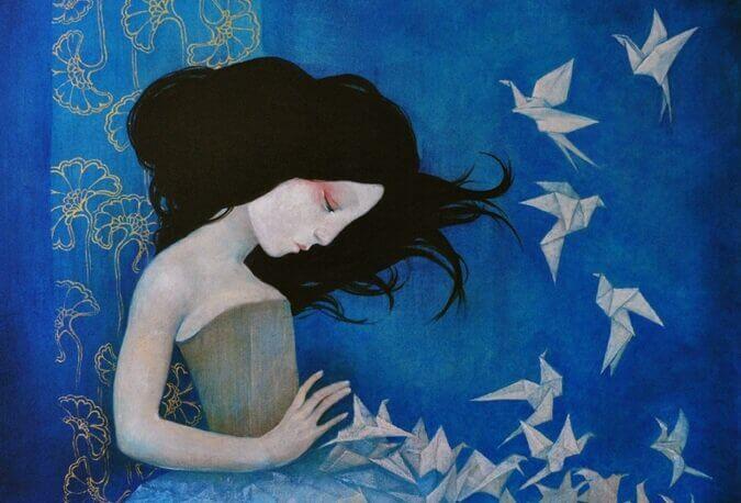 Pige med fugle af papir