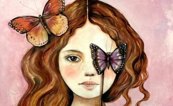 Kvinde har sommerfugl som øjet for at symbolisere energityve