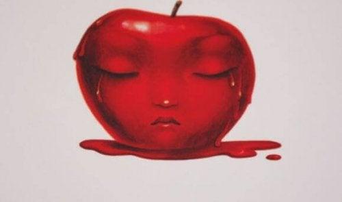Trist ansigt på rødt æble