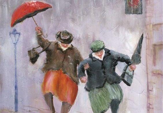 Ældre kvinder med unge sind danser med paraplyer