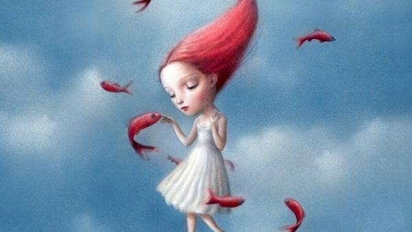 Pige med rødt hår rører ved fisk for at undgå at føle vrede