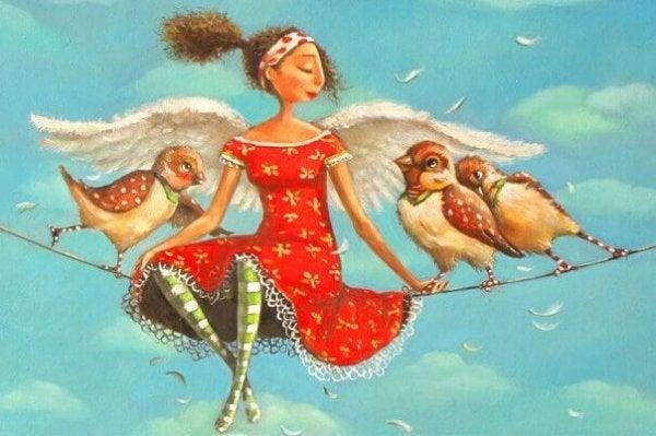 Kvinde sidder på snor med fugle
