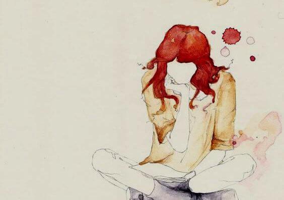 Kvinde med rødt hår sidder på gulv