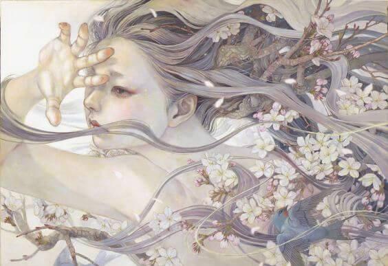 Kvinde med flyvende hår og blomster