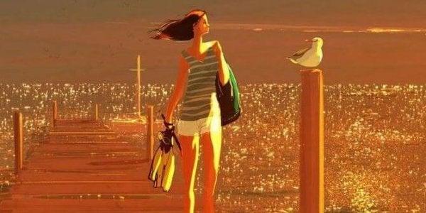 Kvinde går på badebro ved hav og føler sig ikke alene