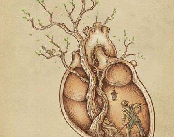 Mand i er træ formet som et menneskehjerte