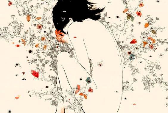 Nøgen kvinde ligger i fosterstilling i blomster