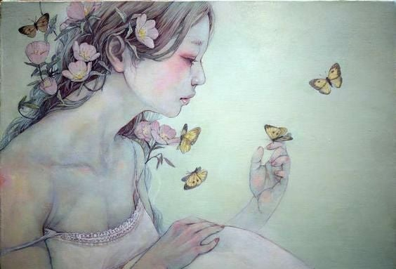 Trist kvinde med sommerfugle