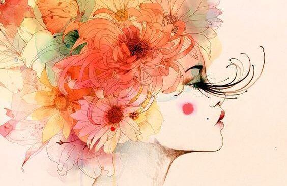 Kvinde med blomster i hår viser det smukke ved at blive stærkere efter en skuffelse