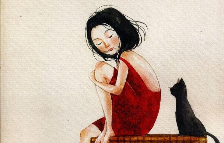 Kvinde i rød kjole sidder med kat