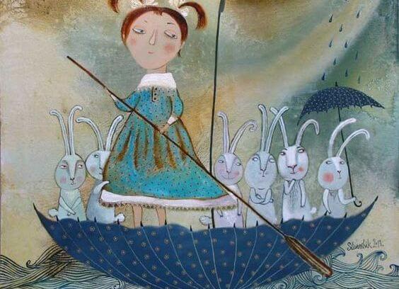 Pige i omvendt paraply med kaniner forstår, hvordan man skal leve sammen