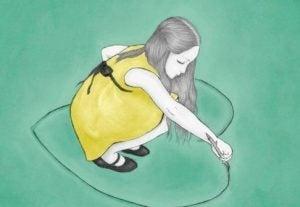 Boost din selvkærlighed som denne pige, der tegner et hjerte på jorden