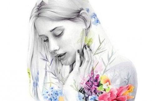 Pige i sort hvid med farvede blomster