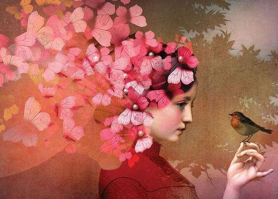 Pige med blomster som hår holder fugl