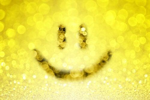En smiley symboliserer den positive holdning ved uimodståelige mennesker