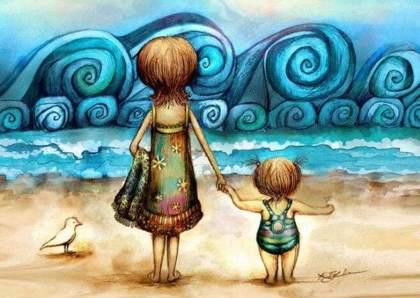 Barn og voksen på strand