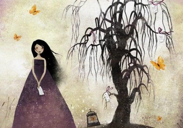 Pige under vissent træ