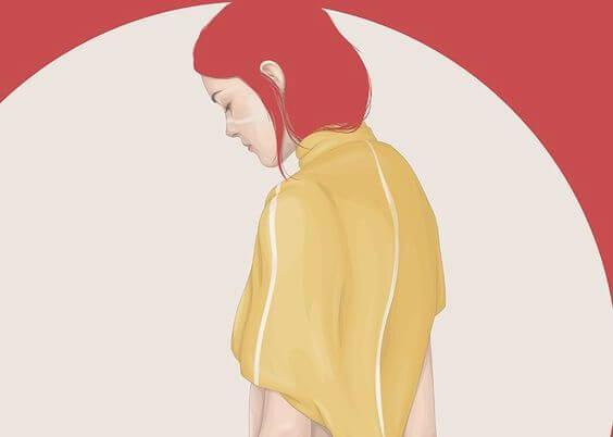 Trist kvinde med rødt hår lader frygten overtage