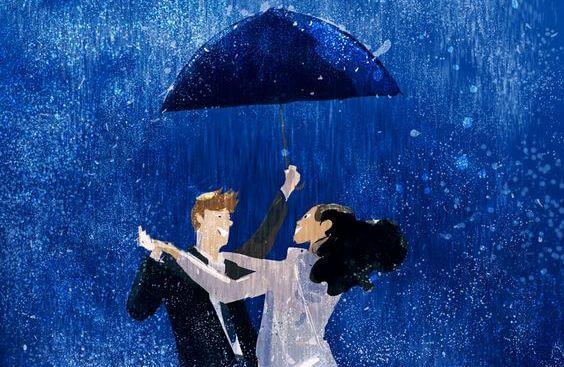 Par danser i regnen under paraply