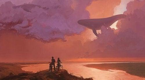 Personer cykler og ser hval på himmel
