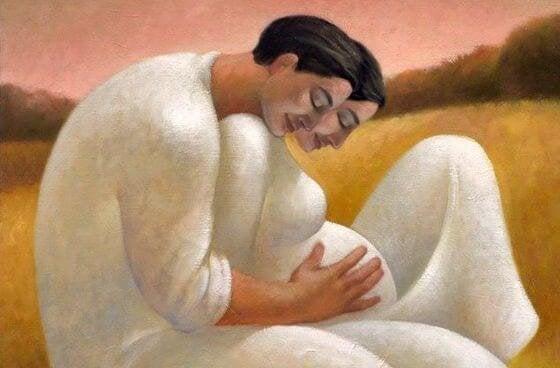 En far krammer gravid mor