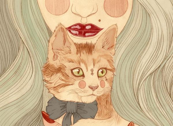 Kat foran kvindes ansigt