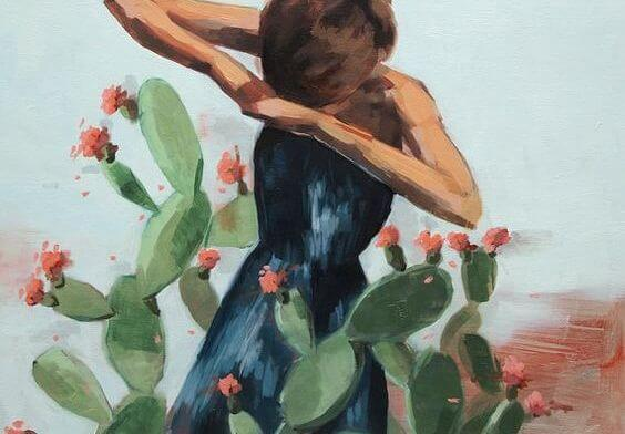 Kvinde mellem kaktusser