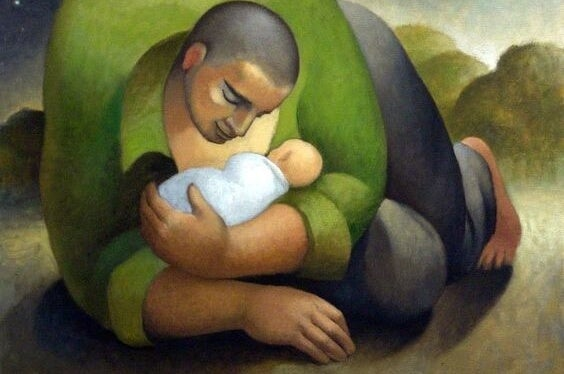 En far krammer sin baby