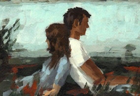 Mand og kvinde sidder med ryggen mod hinanden