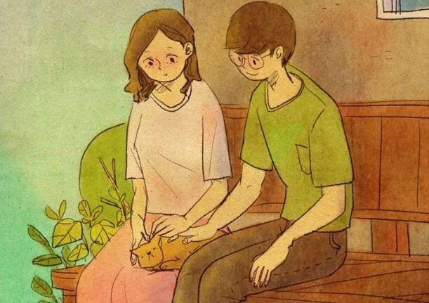 Par sidder og kæler med kat