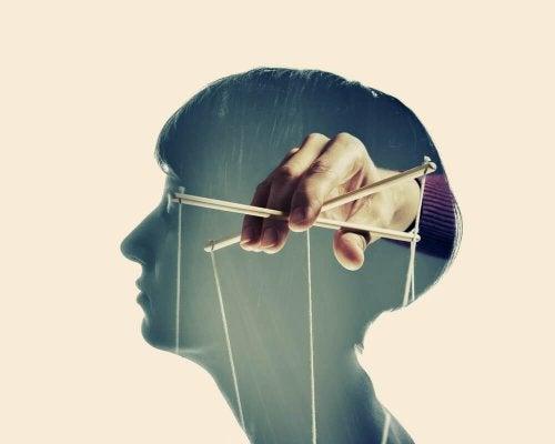 Dukkefører i hoved symboliserer følelsesmæssig manipulation