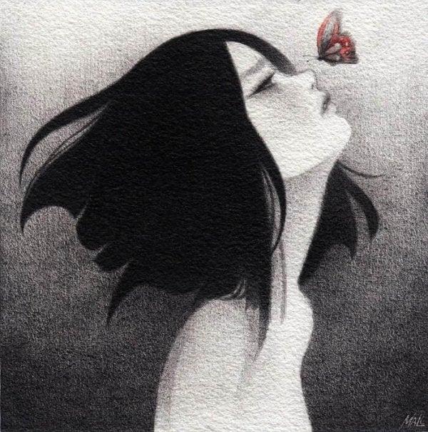 Sommerfugl ved at lande på piges næse
