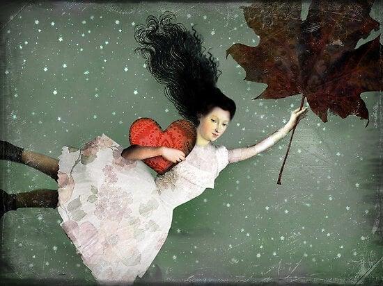 Kvinde flyver ved hjælp af blad og med hjerte i hånden