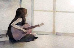 Kvinde med guitar er en autentisk person