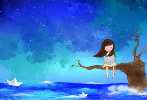 Pige sidder på gren over hav