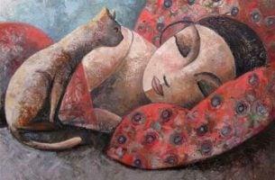 Kvinde med kat sover