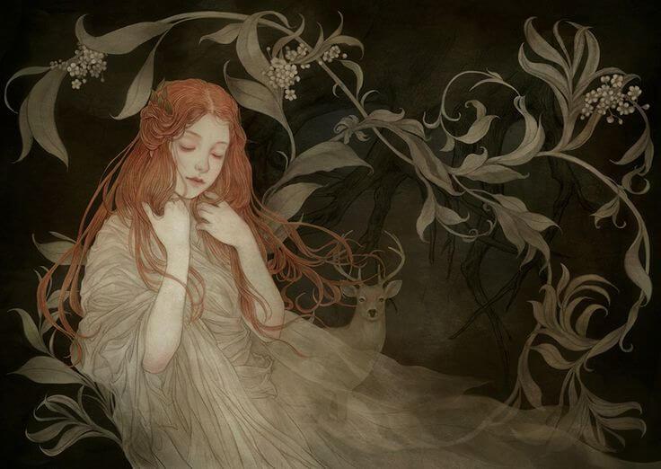 Kvinde i skov med hvid kjole udviser følsomhed