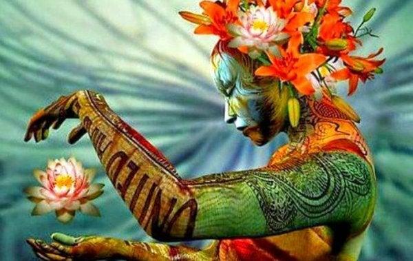 Kvinde med lotusblomst bliver født på ny