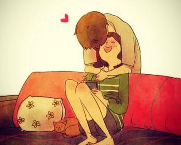 Mand kysser kvinde i sofa, da han er sammen med den ideelle partner