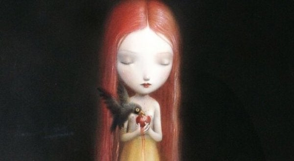Pige lader fugl spise hjerte