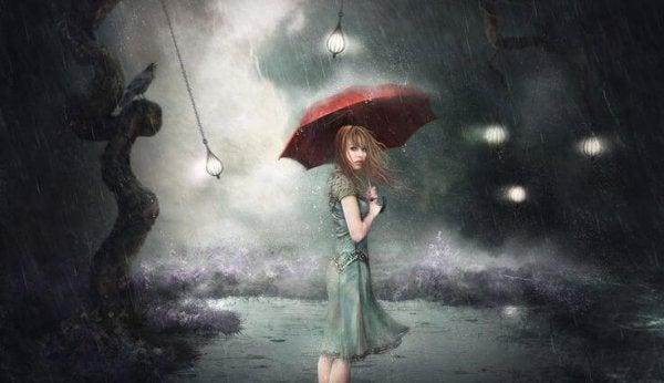 Kvinde i regn med paraply