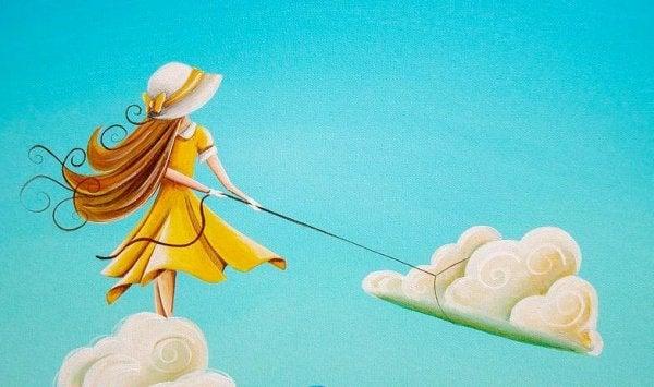 Pige trækker i sky