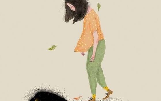 Trist kvinde med en dårlig attitude går med hovedet bøjet