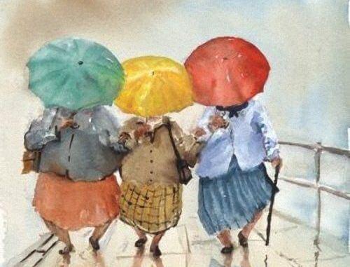 Venner gemmer sig bag paraplyer